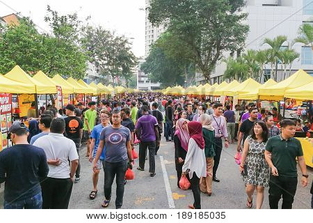 Kuala Lumpur, Malaysia, May 29, 2016: Muslim Shopper Buying Food From Street Vendor For Breaking Fas