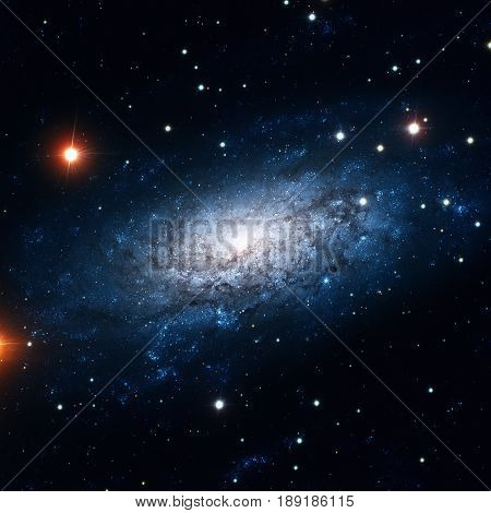 NGC 3621 is a field spiral galaxy in the constellation of Hydra. Retouched colored image. Elements of this image furnished by NASA.