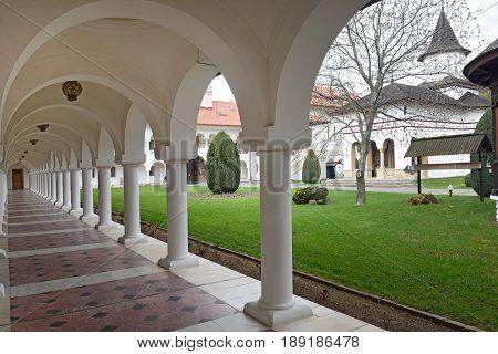 Arched and building in Sambata de Sus monastery in Transylvania Romania