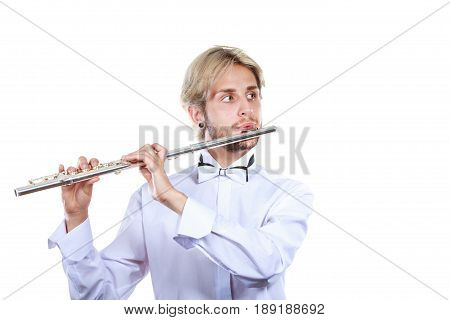 Flute music playing professional male flutist musician performer. Young elegant stylish man with instrument