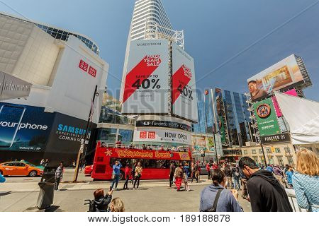 Toronto, Ontario, Canada, down town, May 20, 2017, beautiful inviting view of down town Toronto young street with various modern buildings, billboards and people walking in background