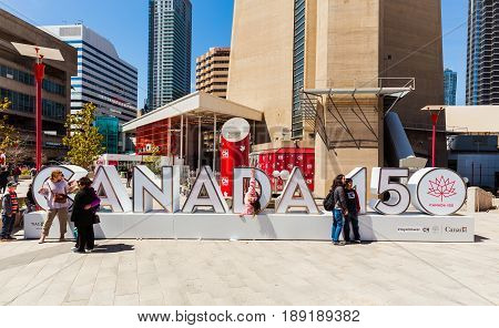 Toronto, Ontario, Canada, down town area, May 20, 2017, amazing gorgeous inviting view of many people and children walking, sitting, relaxing and enjoying their weekend time on sunny day