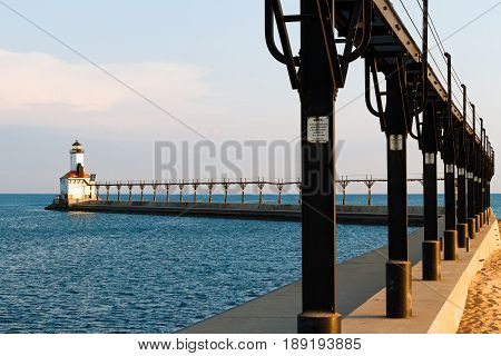 Lighthouse with elevated catwalk approach at Michigan City Indiana on Lake Michigan USA