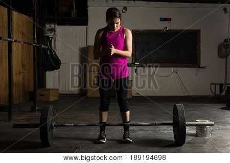 Woman Getting Ready To Lift A Barbell