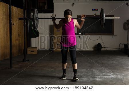Active Woman Doing Barbell Squats