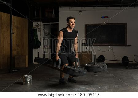 Attractive Athlete Showing His Strength