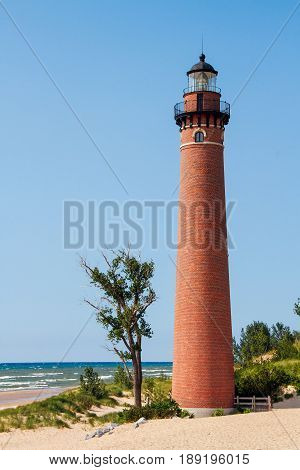 The Little Sable Point Lighthouse stands on a sandy beach of Michigan's Lake Michigan coast in Silver Lake State Park.