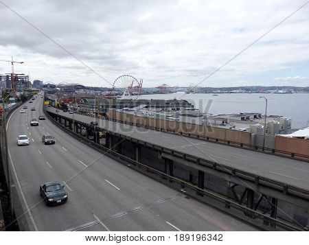 SEATTLE USA - JUNE 25 2016: Cars drive along State Route 99 runs along the Seattle seaboard as a double-decked highway system known as the Alaskan Way Viaduct which is scheduled to be replaced with a tunnel.