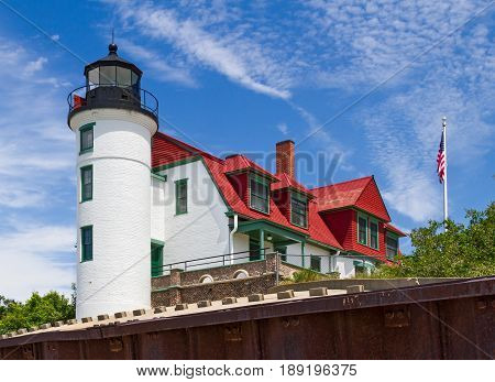 The Point Betsie Lighthouse completed in 1858 is located on Lake Michigan north of Frankfurt Michigan and marks the south entrance to the Manitou Passage.
