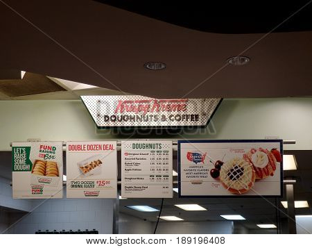 SEATTLE - JUNE 24: Inside of the Krispy Kreme Doughnut Seattle in June 24 2016. Krispy Kreme Doughnuts Inc. is an American global doughnut company and coffeehouse chain based in Winston-Salem North Carolina.