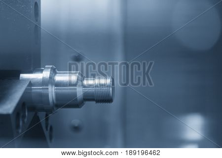 The aluminium screw thread on the CNC lathe or CNC turning in light blue scene.New technology manufacturing concept.