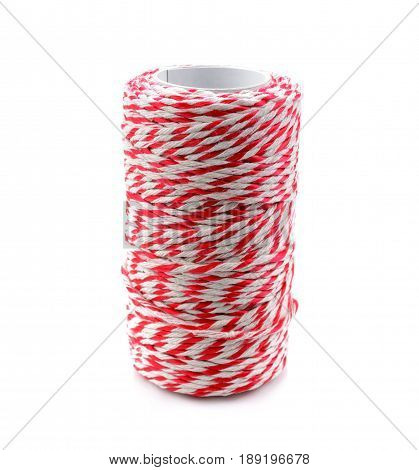 Red and white baker's twine spool for packaging mail box isolated on white background