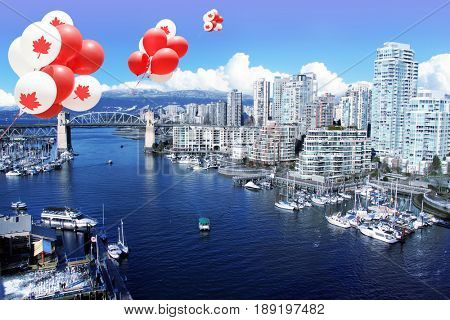 Canadian maple leaf balloons floating over the city of Vancouver for Canada day.