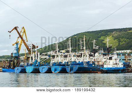 Petropavlovsk-Kamchatsky, Russia - August 15, 2016: Border patrol ships of the Coast Guard and harbor cranes near the coast of Kamchatka.