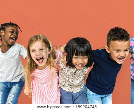 Group of happiness little children huddle together
