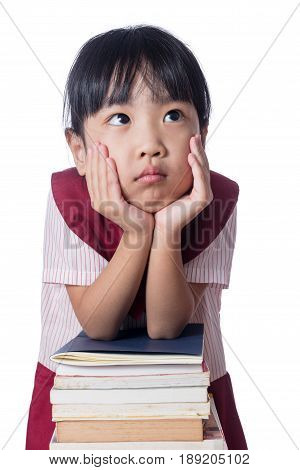 Asian Little Chinese Girl With Piles Of Books