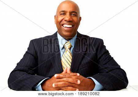 Mature African American businessman isolated on white.