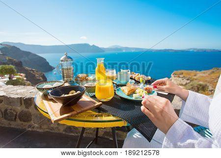 Woman having delicious breakfast in Mediterranean summer