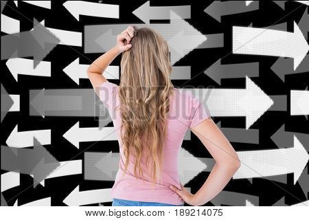 Digital composite of Digitally generated image of confused woman looking at arrows in background