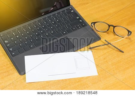 Modern laptop computer and object business on workspace with wooden table effect light selection focus.