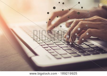 Double exposure of business man hand working on blank screen laptop computer on wooden desk as concept with social media diagram / soft focus picture