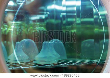 Bottle baby milk set sterilize uv and dry in modern technology incubators.