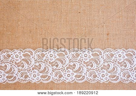 background - natural color burlap hessian with white flower lace border