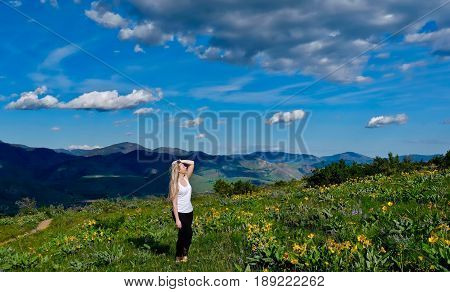 Young blond woman hiking in alpine meadows. Patterson Mountain. North Cascades National Park. Winthrop. Seattle. Washington. United States.