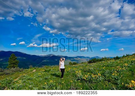 Happy smiling woman hiking in meadows. Patterson Mountain. North Cascades National Park. Winthrop. Seattle. Washington. United States.