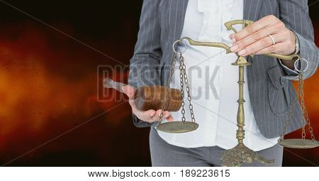 Digital composite of Midsection of judge holding law scales and hammer