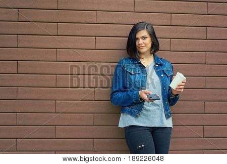 Beautiful  Brunnete Young Woman With Tunnels In The Ears In A Blue Jeans Jacket