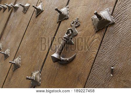 Detail of an old wooden door detail of a door knocker
