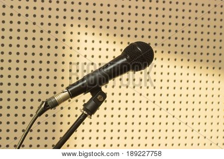 Black microphone on the background wall in the studio for practicing vocals