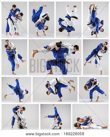 The two judo fighters fighting on gray studio background. Collage