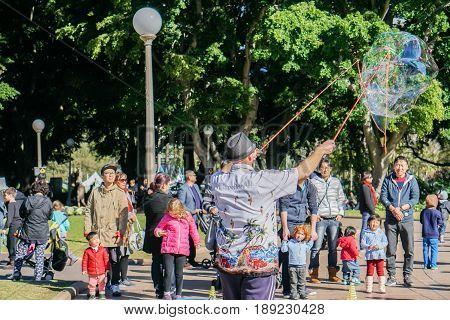 people spend family time in Hyde Park on weekend taken in Sydney Australia on 4 July 2016