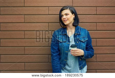 Beautiful  Brunette  Girl With Tunnels In The Ears In A Blue Jeans Jacket