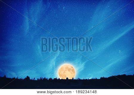 Full Moon At Night On The Dark Blue Sky