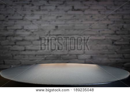 Selected focus empty black wooden table and wall texture or old black brick wall blur background image. for your photomontage or product display.