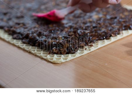 Coating Chocolate Topping With Wallnuts On Cake Crust