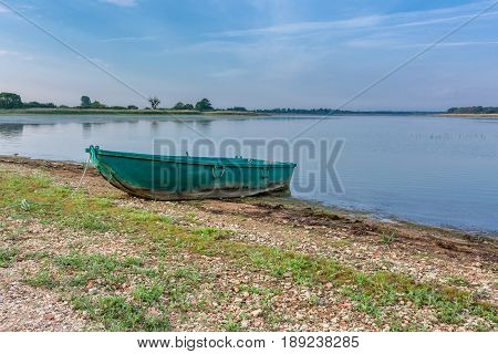 French countryside. A small lake in the Parc Naturel Regional de Lorraine at sunrise with small boats.