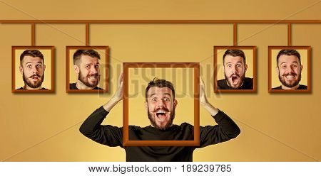 Young man trying on her emotions on gold studio background