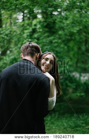 lovely couple higging in city park in spring day
