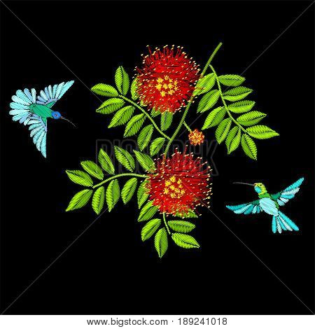 Embroidery birds and tree blossom branch isolated on black background. Blue hummingbirds and Calliandra flowers.