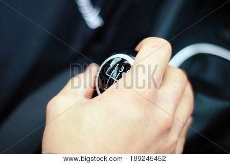 Hand shifting a gear. Manual Transmission of VW GTI