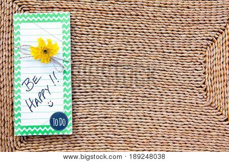To Do List - Be Happy on straw mat background