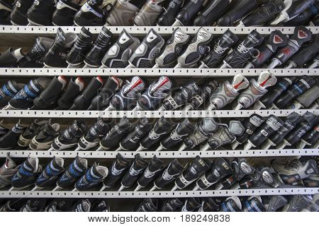 TORONTO, CANADA. December 28, 2014: Ice-skating shoes on the shelves inside a winter sports store in Toronto, Canada. Rental. Ice skates.