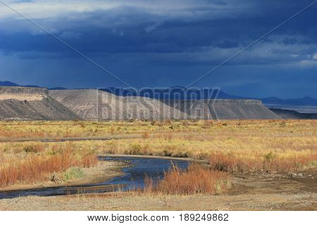 Rio Grande river with nice mountains in the background in Neuquen, Argentina