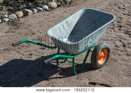 Empty Garden Two-wheeled Metal Wheelbarrow