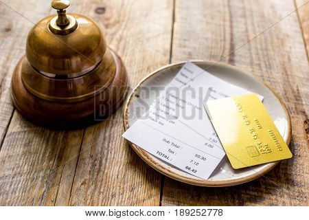 Restaurant Bill Paying By Credit Card And Ring On Wooden Table Background