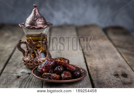 Ramadan kareem holiday concept with iftar dates, rustic background
